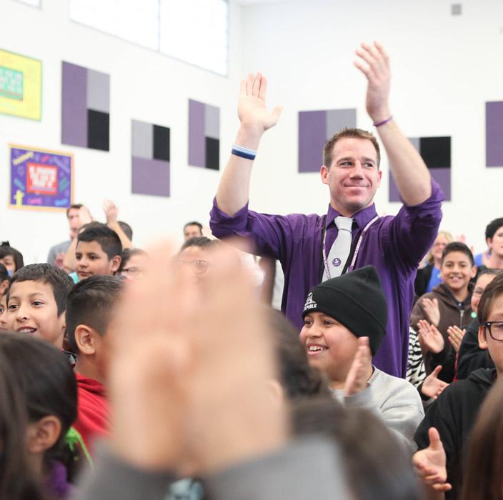 Matt in Assembly clapping hands