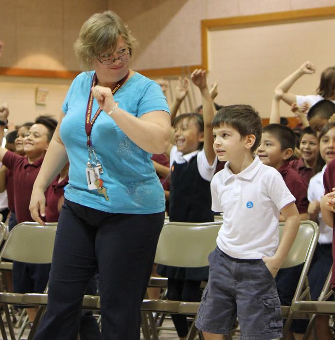 teacher and kid dancing