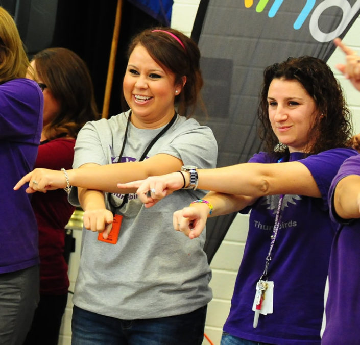 teachers dancing with signals